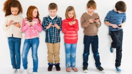 Children using mobile phones_Photo Courtesy: Boston College, Carroll School of Management